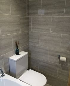 walk in master shower with fully tiled shower walls and clear