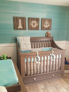 Great crib with storage beneath. And gorgeous grasscloth wallpaper. House of Turquoise: Coastal Inspired Nursery ..................................................Caution: This is for design inspiration only. For all safety-related information, please visit www.deltachildren...