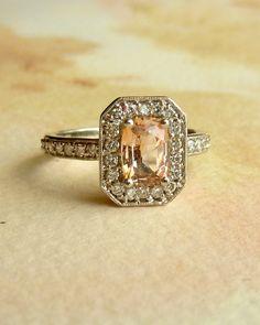 Paparadascha Sapphire and Diamond Halo Ring.