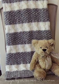 """This blanket features a fun mixture of textures and cables. The name, """"Cabled and Gray"""" is a play on the words, """"dappled and gray"""" from the nursery rhyme, All the Pretty Little Horses."""