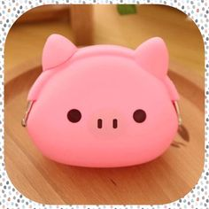 New Cute PINK PIG Silicone Coin Purse Cute pig coin purse in pink. The wide-set ears open much like a kisslock closure. Made of rubbery silicone with a metal reinforced hinge opening. Adorable! Bags Wallets