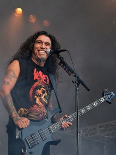 Tom Araya/Slayer.  Happiest metal singer ever!  <3