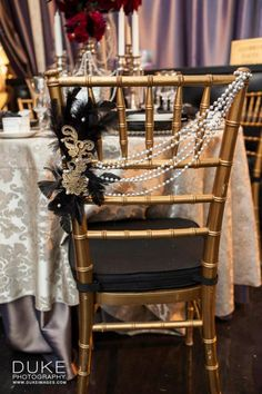 Gold and Black - Diagonally dropped pearls with feathers on the side, photo by Duke Photography