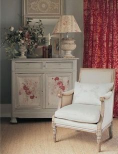 French influenced shabby chic by interior designer Kate Forman.  Love the shades of pink and red