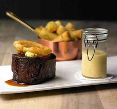 """Steak and potatoes take on a new form in the two-Michelin starred gastropub, The Hand & Flowers in Britain. The pub champions """"unpretentious modern British flavours"""" and """"rustic French dishes""""."""