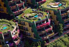 Inspiration for your Guerilla Gardening!Obviously I must say that,I have never seen before such this awesome buildings.How awesome that you grow lots of thing in your apartment.If you live in the apartment,you should know how it is difficult to grow flower or gardening.It is located in Phuket, Thailand.That's a lot of flowers, part of the lease agreement that you must maintain flowers.