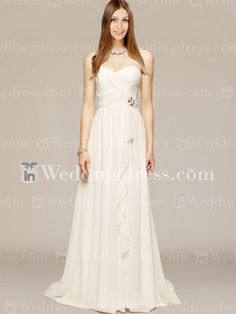 Beach wedding dress features shirred, asymmetric bodice with cascading skirt.