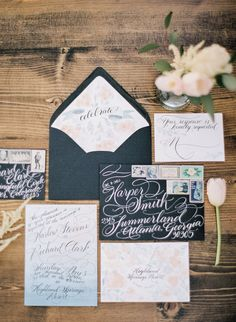 Stunning black and floral invitation suite: http://www.stylemepretty.com/california-weddings/cherry-valley-california/2015/09/02/whimsical-olive-grove-wedding-styled-shoot/   Photography: Fern Shin - http://www.fernshin.com/