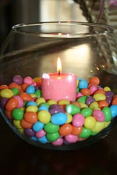 EASTER DECOR Jelly bean candles were the perfect decoration. Random Tip: when the wax melts and becomes one with the jelly beans, place the whole container in the freezer for 5 minutes. Everything will pop right out for easy clean up! Easter Dinner, Easter Party, Easter Table, Hoppy Easter, Easter Eggs, Easter Food, Easter Bunny, Diy Easter Decorations, Table Decorations