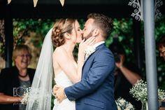 first kiss wedding photo