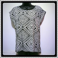 Black and white patterned top Hi low style. Cute diamond design. On the back side has elastic straps up at the top. (Pic 4) horizontal and criss cross design. Not sure what the material is but has a silky feel. Caramela Tops Blouses