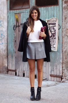 Clean combination. Black coat, white tee, grey skirt, berry clutch, black ankle boots. #streetstyle