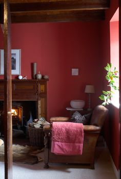 Rich and warm, pink and red sitting room