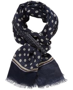 684a24c9d481 This wool scarf is made using a lightweight wool and features an exquisite  print.