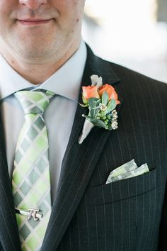 Orange and green groom outfit accessories - green plaid tie, matching pocket square, and a rosebud and wax flower boutonniere {B. Jones Photography}