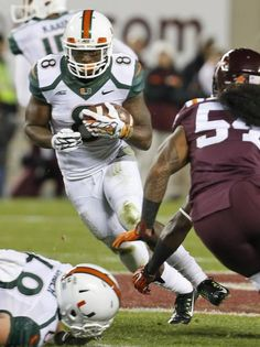 Miami running back Duke Johnson (8) makes a cut during the first half of an NCAA college football game at Scott Stadium in Blacksburg, Va., Thursday, Oct. 23, 2014.