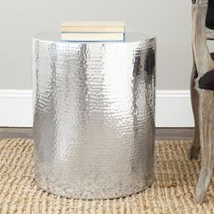 With a highly polished aluminum and hammered finish, the Polonium drum table takes the basic cylinder to new heights of fashion as a contemporary column to hold a lamp or favorite treasure.