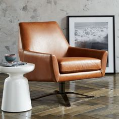 http://www.westelm.com/products/lucas-leather-swivel-base-chair-h1545/?pkey=cliving-room-chairs|all-living-room-chairs