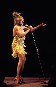 Tina Turner's Gold Fringe Mini Is One Of The Sexiest Dresses Of All Time