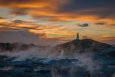 Steam rises out of the ground near a lighthouse in Reykjanesskagi (translated literally as 'smoke headland peninsula'). Lighthouse, Monument Valley, Nature, Travel, Bell Rock Lighthouse, Light House, Naturaleza, Viajes, Lighthouses