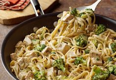 This family-friendly dish features cooked chicken, broccoli and a savory mushroom soup tossed with hot cooked linguine and Parmesan cheese. It's a 30-minutedish that's simply irresistible.