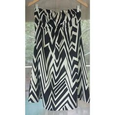 Black and white strapless print dress Black and white strapless dress. Fully lined. Side zip closure. Great dress that stays up!! Shell: 96% polyester/4% spandex. Lining: 100% polyester. 1115 The Limited Dresses