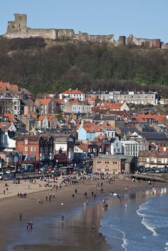 went here with Lucy and Jess... walked along and then ate fish and chips on the boardwalk, then up to the castle... wonderful day!  Scarborough , Yorkshire UK with the 12th century Scarborough Castle in the distance by Karl Newell & Andrew