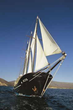 Ship sailing through the Galapagos Islands.