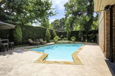 4537 PIN OAK. Lush landscaping surrounds salt water heated swimming pool with spa. Bernstein Realty, Houston Real Estate