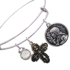 """Rosemarie Collections Women's Religious Charm Bangle Bracelet """"Saint Joan of Arc"""". Religious bracelet featuring Joan of Arc and 4-Way Cross Medals. Size: 2.5 inch opening for a small to medium size wrist. Fashionable silver tone wire bangle with hook closure. Crystal dangle charm adds a sparkle accent to the design. Joan of Arc has been a popular figure in literature, painting, sculpture, and other cultural works since the time of her death, and many famous writers, filmmakers and…"""
