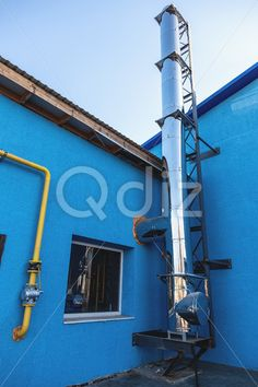 Qdiz Stock Photos | Smoke pipe on industrial building,  #background #blue #building #chrome #construction #detail #duct #exterior #factory #heat #industrial #industry #metal #pipe #plant #sky #smoke #smokestack #steel