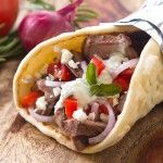 Grilled Lamb Gyros With Tzatziki Sauce ...~ I LOVED eating these while over in Germany for 3 years!  We frequented the Greek food stands often! YUM. Don't forget to add in pepperoncinis (Sp?) too! NeecieKay