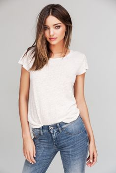 Miranda Kerr. She is absolutely stunning. Such natural sweet beauty. And her dimples...God I wish I had those.