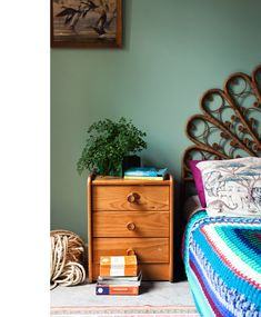 Home of Emilio Fuscaldo and Anna Krien. Love the ornate bedhead.