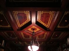 Faux wood inlay on library ceiling by Jeff Raum.