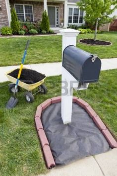 Laying Mulch Around The Mailbox And Placing Edger Bricks. Stock … Laying Mulch Around The Mailbox And Placing Edger Bricks. Mailbox Garden, Mailbox Landscaping, Outdoor Landscaping, Lawn And Garden, Outdoor Gardens, Landscaping Ideas, Mailbox Plants, Mulch Ideas, Backyard Ideas