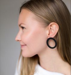 Korona means a light phenomena. Korona series jewelry is made of Finnish birch.The earrings are made ecologically (zero waste) from circles that are inside each other. We make the products in Finland. The black circle stud earrings of the Korona series were given the FORM#2018 design award in Frankfurt. Designed by Elina Mäntylä. Follow us for jewelry inspiration ❤️ #NordicDesign #FinnishDesignJewelry #ZeroWasteDesign #SustainableFashion #StatementJewelry #WoodenJewelry #MadeInFinland Nordic Design, Wooden Jewelry, Design Awards, Frankfurt, Zero Waste, Statement Jewelry, Sustainable Fashion, Finland, Birch