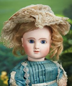 """16"""" Pretty French Bisque Bebe, Figure C, by Jules Steiner~~~Marks: Steiner Paris Figure C 1 (head) (original Steiner paper label on torso). Comments: Jules Steiner, circa 1888. Value Points: very pretty shy-faced child with fine delicate bisque, original body and body finish, lovely antique blue silk dress, undergarments, stockings, shoes, and ruffled bonnet."""