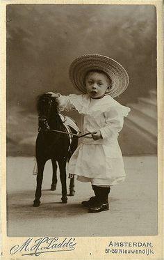 Antique Photo Album: Boy with toy horse