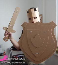 Cardboard Shield for your little knight. Diy craft for kids fun and games. Cardboard Sword, Cardboard Costume, Cardboard Toys, Cardboard Playhouse, Cardboard Furniture, Cardboard Crafts Kids, Lego Costume, Thick Cardboard, Diy Crafts For Kids