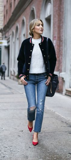 velvet tommy hilfiger varsity bomber jacket, ripped jeans, red suede pointy toe heels pumps, navy leather bucket bag