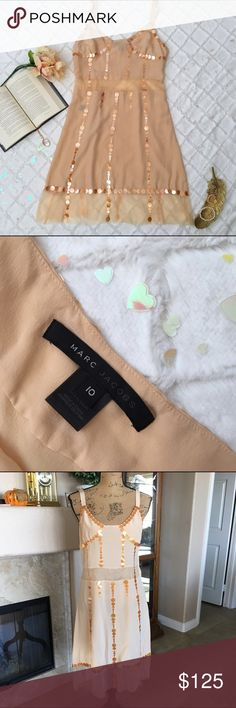 """🆕 Listing Marc Jacobs Designer Dress Stunning dress by Marc Jacobs! The color is peach. There is a mesh fabric around the waist area. On one side, there are hidden snaps instead of a zipper. Tulle fabric adorns the bottom of the dress. The bust measures approx 36"""" and the length 39"""". 100% Silk. Dry clean only. Marc Jacobs Dresses"""