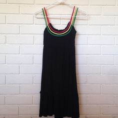 """Dress with colored straps This is a very comfortable black dress with red, yellow and green straps. I am 5'5"""" and it hangs 2 inches above my knee. I've worn this dress a couple of times and have gotten multiple compliments on it! It's very versatile, it can be worn on a night out or even on a beach day. You will love it! ✨ Grievergate Dresses Midi"""