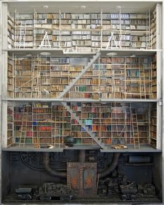 Marc Giai-Miniet constructs some elaborate dioramas of libraries -> http://fineprintnyc.com/blog/the-diorama-libraries-of-marc-giai-miniet