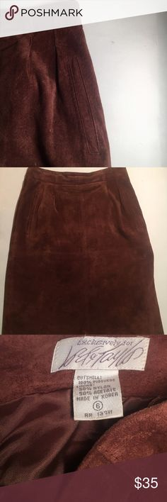 Lord and Taylor vintage  suede skirt This brown four panel suede pencil skirt is perfect for the office, a dinner date, or just casual wear! It features waistband pleats, deep vertical pockets, and a side zip, shown in picture Also has a back slit. Falls just above the knee! 100% pig suede Lord & Taylor Skirts Pencil