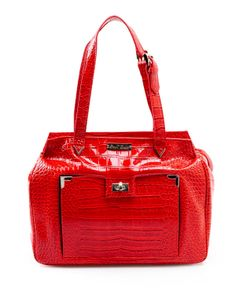 Red. Patent Croc makes this Ipad handbag a delight! It is for the bold, the fun, the adventurous. Since we are all about practicality as well, we have our signature Front flip open Ipad pocket to carry that tech you need most.  We also have an inner padded PC pocket for more technology and a zipper back pocket to carry more of what you want.  Only from the heart of Ethan Julian. www.ethanjulian.com $95