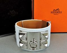 Hermes Collier De chain White Leather CDC Cuff Bracelet By France. Get the lowest price on Hermes Collier De chain White Leather CDC Cuff Bracelet By France and other fabulous designer clothing and accessories! Shop Tradesy now