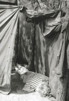 Bergen Belsen, Germany, A woman survivor in an improvised shelter after the liberation, April 1945.