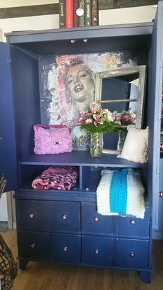 Large armor refinished in country chic  and a Marilyn Monroe shabby vintage piece added to the inside!