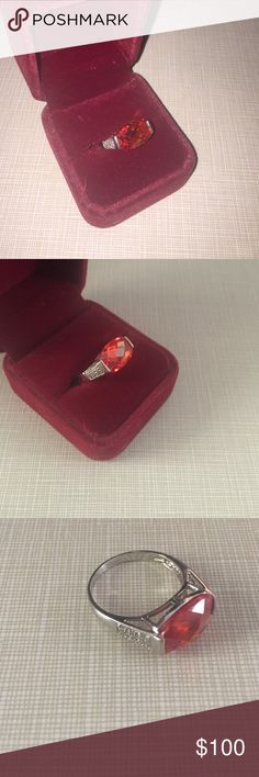 Stunningly beautiful red Mexican fire opal ring Faceted size 10 a rare stone Mexican fire is known for its beauty stamped 925 silver is a substantial ring stone is 1/4' long to half winch wide not a small stone is simply gorgeous specially in the light Jewelry Rings